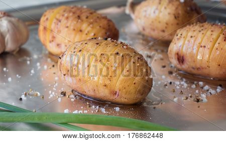 Raw Potatoes With Spice And Onion On Foil. Sliced Baked Potato