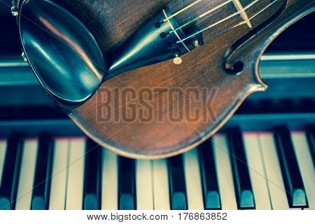 Violin is on piano, art, music, instrument, abstract