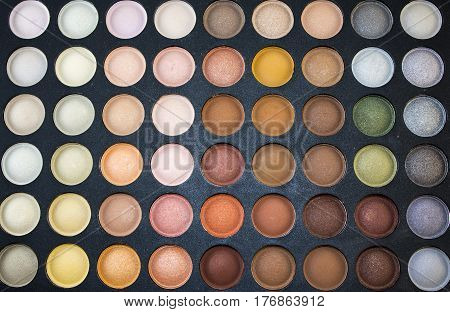 Eye shadow is a cosmetic that is applied on the eyelids and under the eyebrows. It is commonly used to make the wearer's eyes stand out or look more attractive.