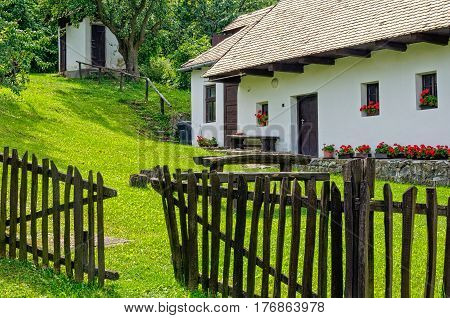 The fence and backyard of a farmhouse in  Holloko, Hungary