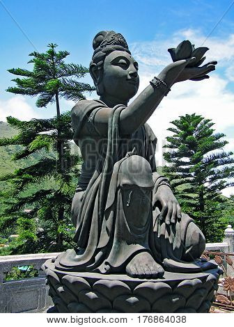 Buddhist statue of a woman in Ngong Ping on the island of Lantau in Hong Kong, praising and making offerings to the Tian Tan Buddha