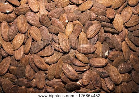The almond that we think of as a nut is technically the seed of the fruit of the almond tree a medium-size tree that bears fragrant pink and white flowers. Like its cousins the peach cherry and apricot trees the almond tree bears fruits with stone-like se