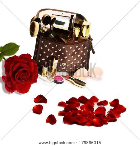 Romantic cosmetic set beautiful red roses isolated on white background.