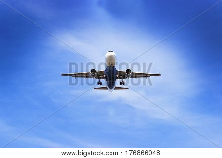 Plane Flying Through Clouds In The Sky. Jet Aircraft.