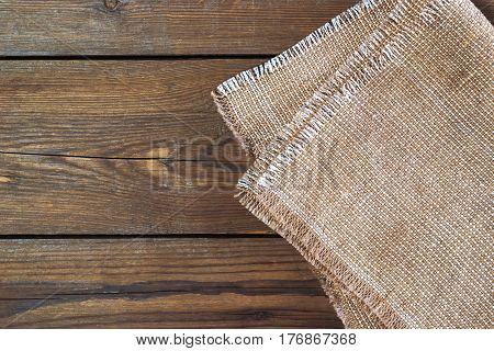 Linen Napkin On Vintage Wooden Kitchen Table. Top View