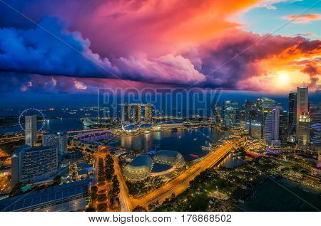 Cityscape at night of Singapore city with day to night camera style marina bay sand and business center.