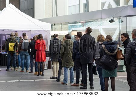 The Hague the Netherlands - March 15 2017: voters lining up to vote in train station polling booth