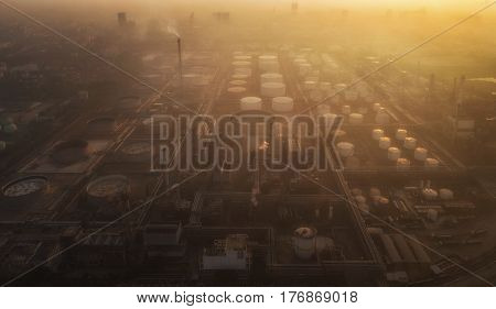Pollution in oil refinery and chemical industry with smoke and fog