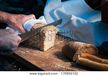bread separate by knife and hand in hotel buffet lunch