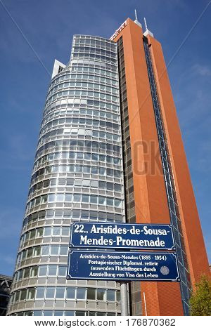 Vienna Austria - August 14 2016: Aristides de Sousa Mendes Promenade street sign in front of Andromeda Tower at the Austria Center Vienna (ACV).
