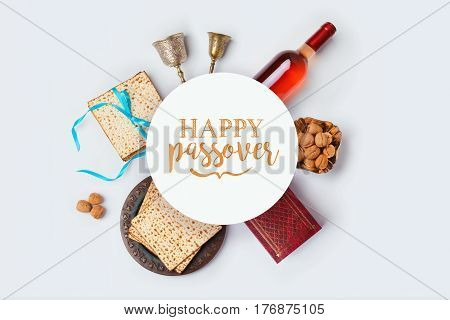 Jewish holiday Passover banner design with wine matza and seder plate on white background. View from above. Flat lay