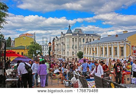 KYIV, UKRAINE - MAY 25, 2013: Andriyivskyy Uzvoz Descent or Spusk with vendors selling souvenirs and walking people