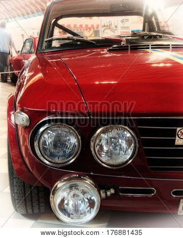 RIMINI , Italy - FEBRARY 12, 2017:Vintage red lancia fulvia hf logo vintage car stands parked