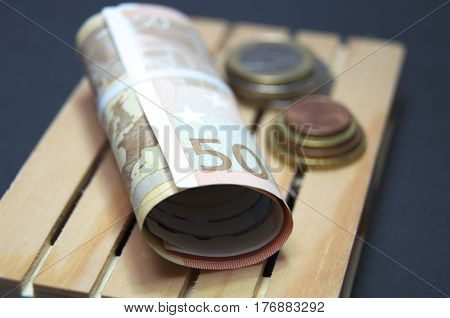 Euro banknotes and coin money on the pallet. Easy for trasnport. Macro photo european currency.