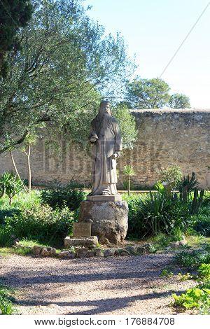 Algaida, Spain - November 8, 2016: Monastery Santuari de Cura statue on Puig de Randa, Majorca. The monastery is the largest and highest of three monasteries on the mountain. It is a very important pilgrimage destination on the island Majorca.
