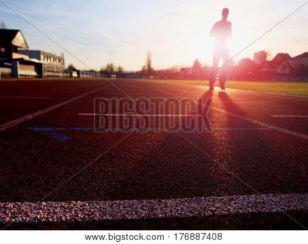 Sportsman In Training At Amazing Sunset  On Stadium