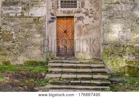 Antique Vintage Entrance Wooden Door To The Old House.