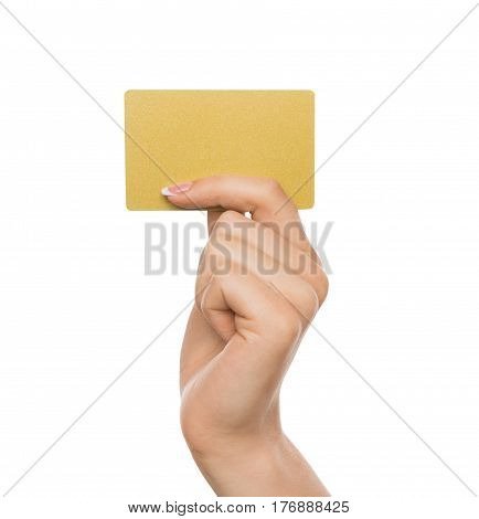 Yellow card. Female hand with french manicure holding plastic credit, woman keeping blank business card on white isolated studio background, copy space, cutout