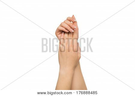 Beauty and skincare, french manicure concept - beautiful female hands, woman touching skin after spa treatment isolated on studio white background, close-up, cutout