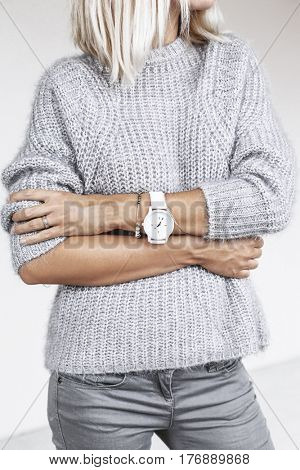 Unrecognizable model wearing casual outfit. Gray clothing in trendy minimalistic style. Street fashion for spring or fall season. Details of everyday elegant look. poster