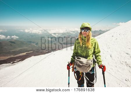 Happy Woman alpinist climbing in mountains glacier Travel Lifestyle success concept adventure active vacations outdoor mountaineering sport alpinism equipment