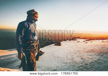 Man alpinist greet the dawn in mountains climbing Travel Lifestyle concept adventure active vacations outdoor epic moments