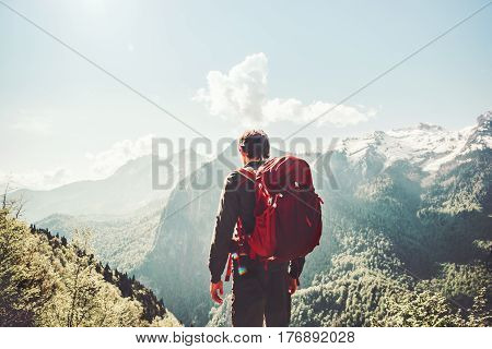 Man traveling in mountains Travel Lifestyle concept adventure active summer vacations wayfaring outdoor hiking sport with red backpack