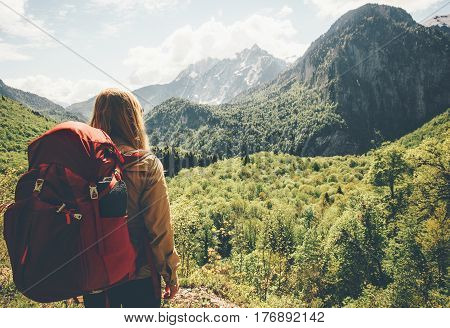 Traveler Woman hiking in mountains with backpack Travel Lifestyle concept adventure summer vacations outdoor mountaineering sport active leisure into the wild