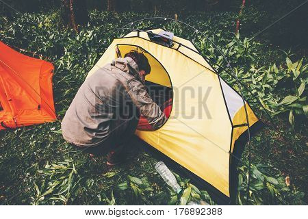 Traveler with tent camping equipment outdoor Travel Lifestyle concept journey adventure active vacations
