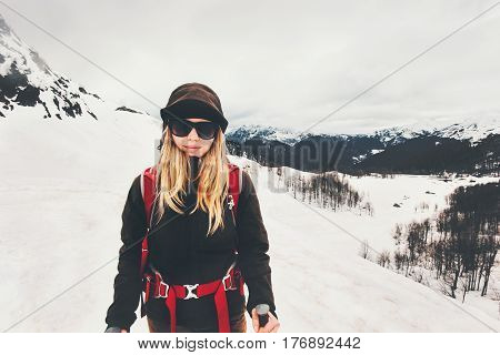 Woman climber hiking in mountains Travel Lifestyle success concept adventure active vacations outdoor mountaineering sport