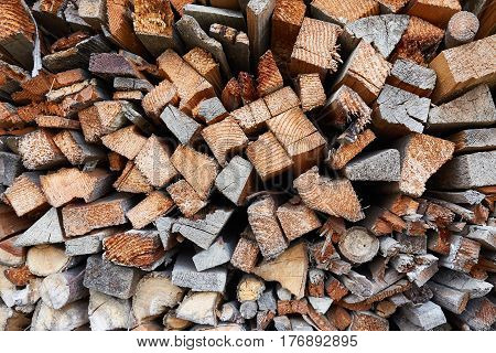 Pile of cut and cleaved firewood. Background.