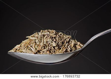 Spoon With Pile Of Cumin Grain