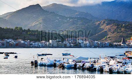 Boat Mooring In Giardini Naxos Town In Evening