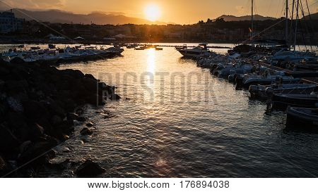 Yacht Mooring In Giardini Naxos Town On Sunset