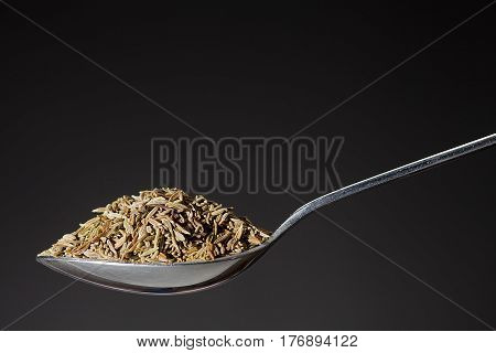 Spoon With Pile Of Cumin