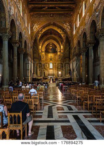 Visitors In Interior Duomo Di Monreale In Sicily