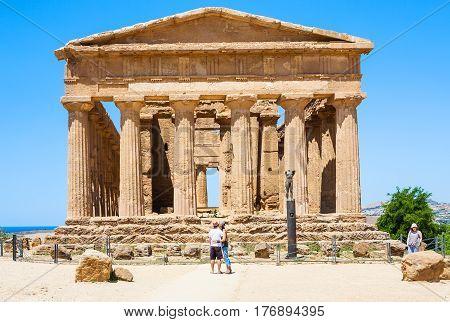 Tourists Near Tempio Della Concordia In Agrigento