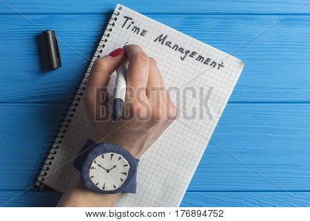 Female Hand with Marker Writing in Notebook. Time Management Concept