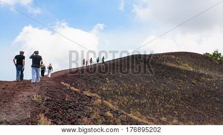 Tourists Walk On Ridge Between Old Crater Of Etna