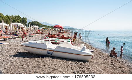 Boats And People On Pebble Beach San Marco