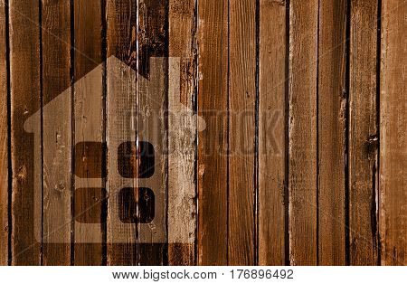 Silhouette Of A House In A Wooden Wall