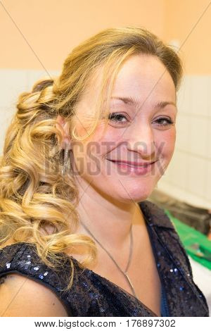 Blonde Woman Of Middle Age With A Beautiful Smile
