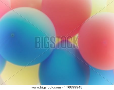 Bleached Blurry Background: Blue Red And Yellow Balloons