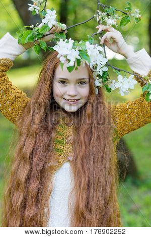 Portrait Of A Cute Girl With Long Red Hair In The Park