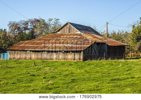 Old Rustic Wooden Barn With Rusted Tin Roof