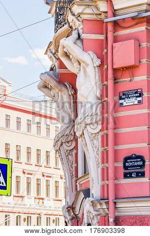 White Telamon Sculptures On Building
