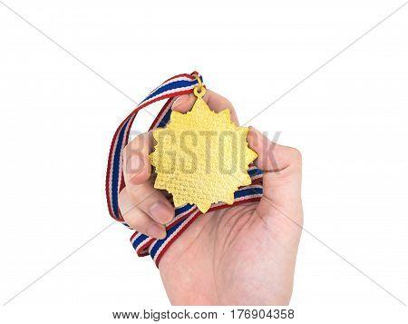 Hand holding Gold medal on white background
