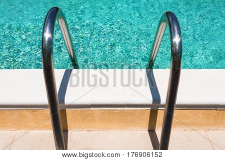 metal handles of outdoor swimming pool in sunny day