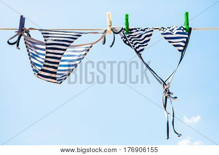 Striped Female Swim Suit Is Dried On Clothesline