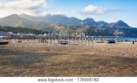 Sand Beach In Giardini Naxos Town In Evening